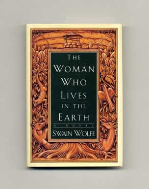The Woman Who Lives in the Earth - 1st Edition/1st Printing. Swain Wolfe.